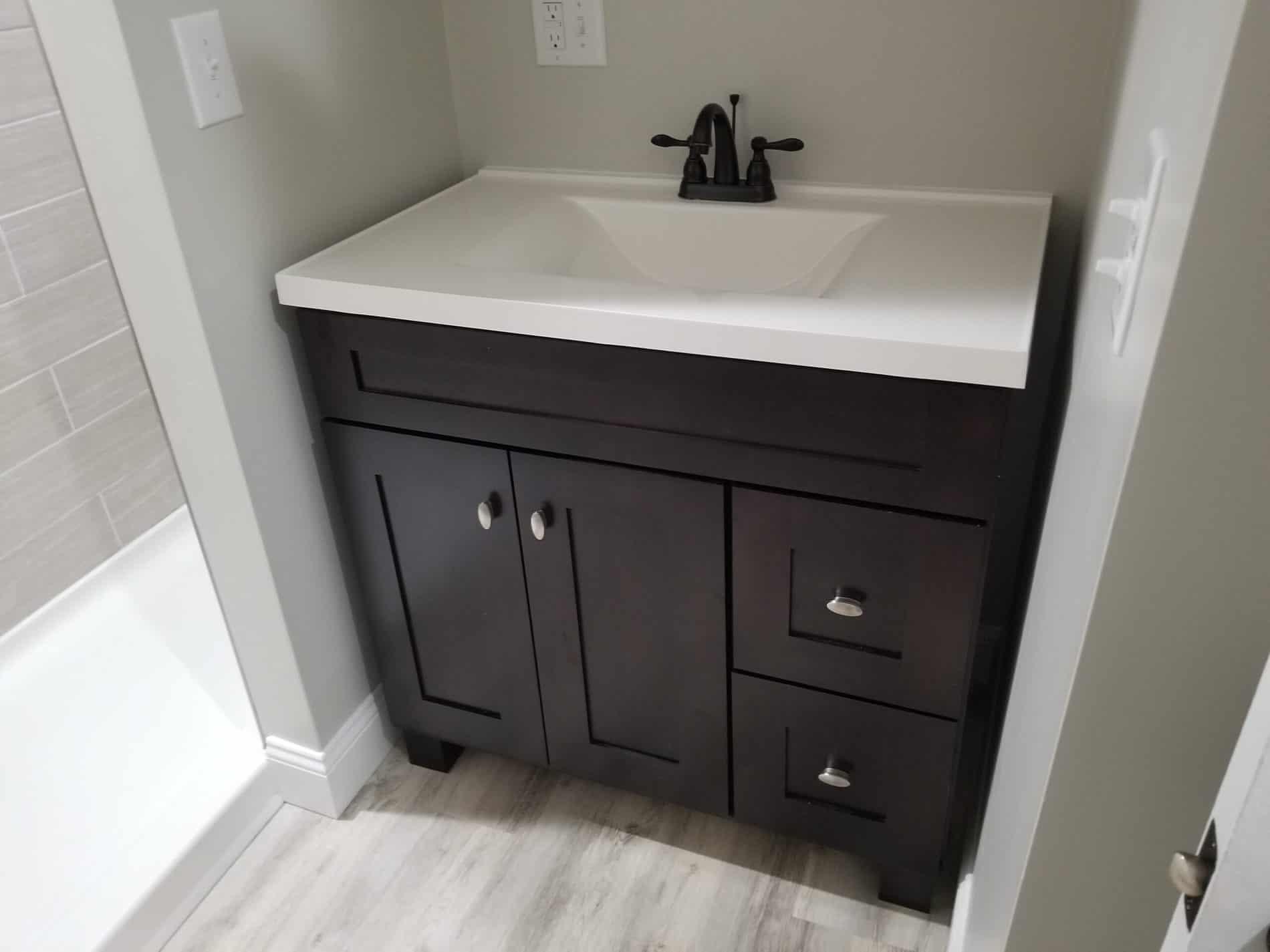 Master Bathroom Remodeling with Dark Vanity