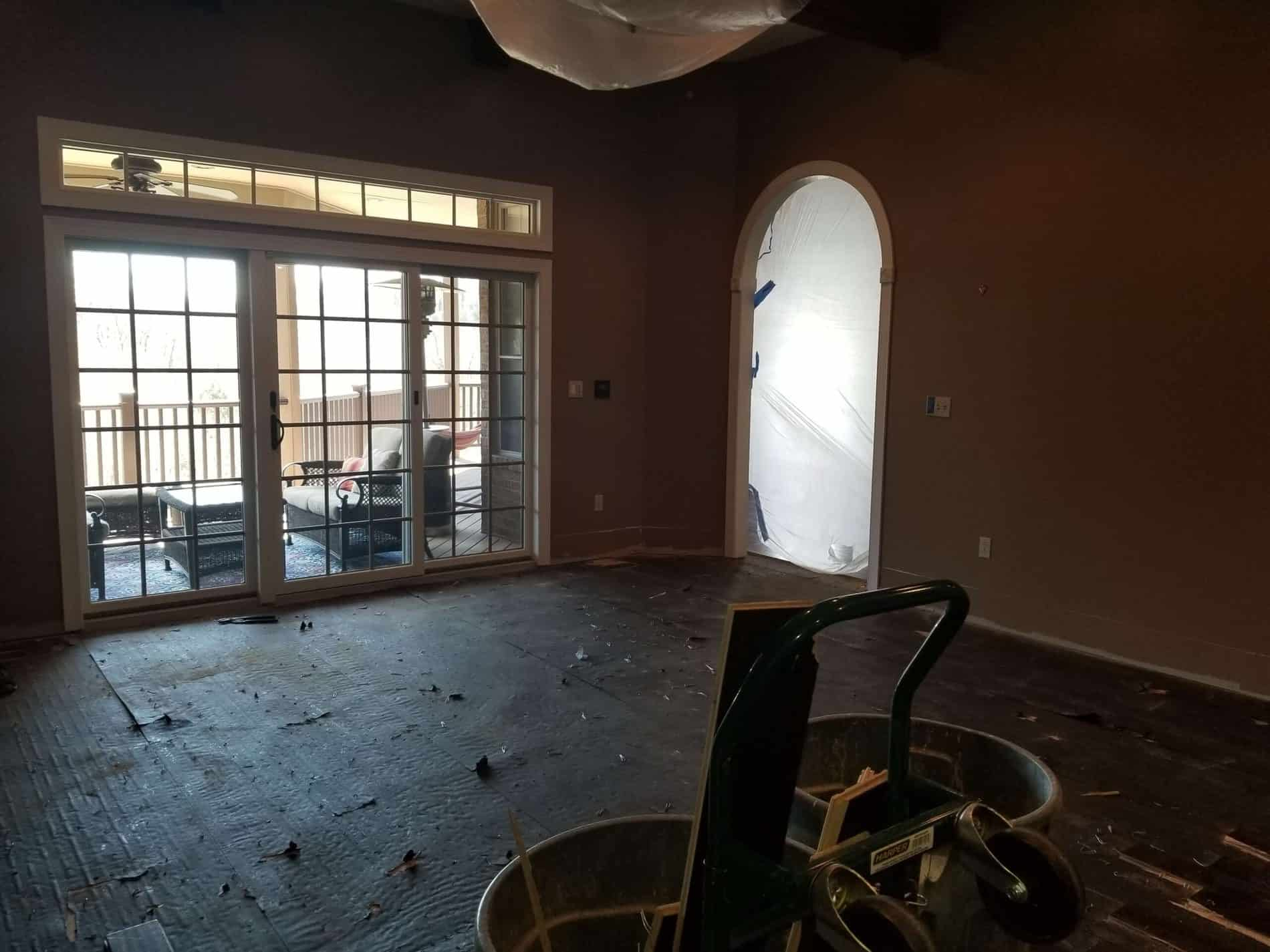 Living room flooring being restored from kitchen water damage